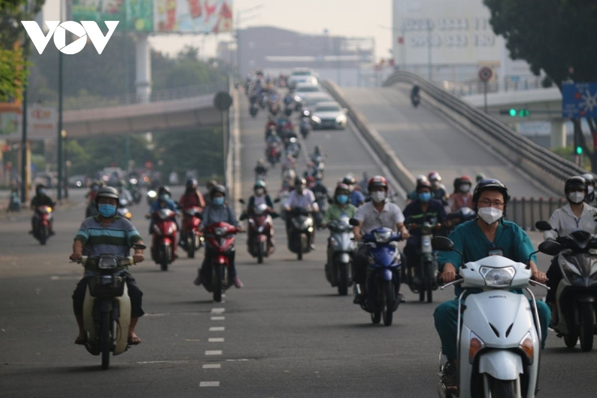 """Ho Chi Minh City eases social distancing measures and moves into a """"new normal"""" state from September 30, although most activities are reopening in a cautious manner and following the """"Safety First"""" slogan."""