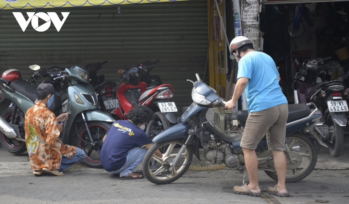 Many local people bring their motorbikes for repairs after the long social distancing period.
