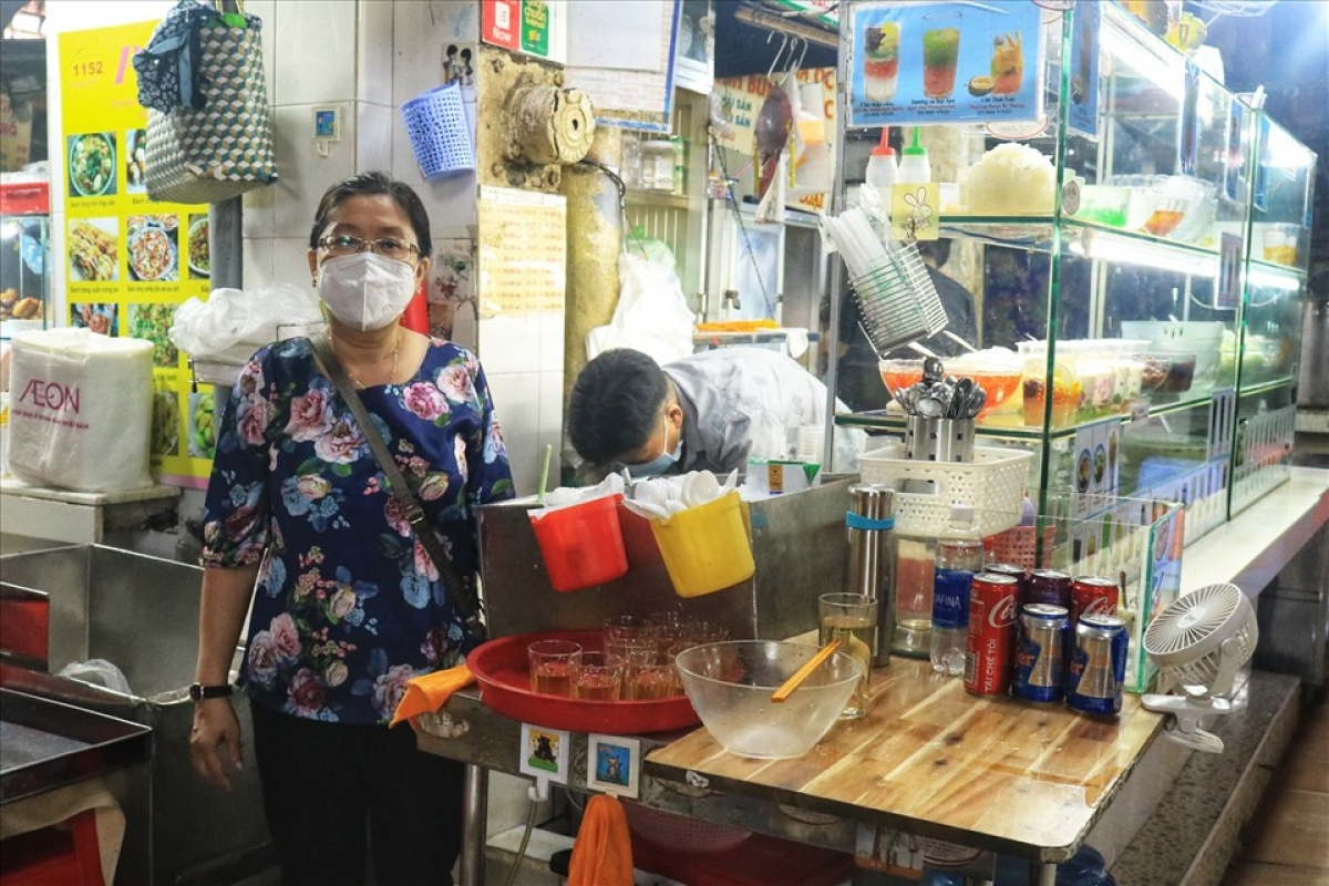A 59-year-old trader says she feels happy at the prospect of reopening her outlet, thereby helping to improve the income for her family which has been heavily impacted by the COVID-19 pandemic.