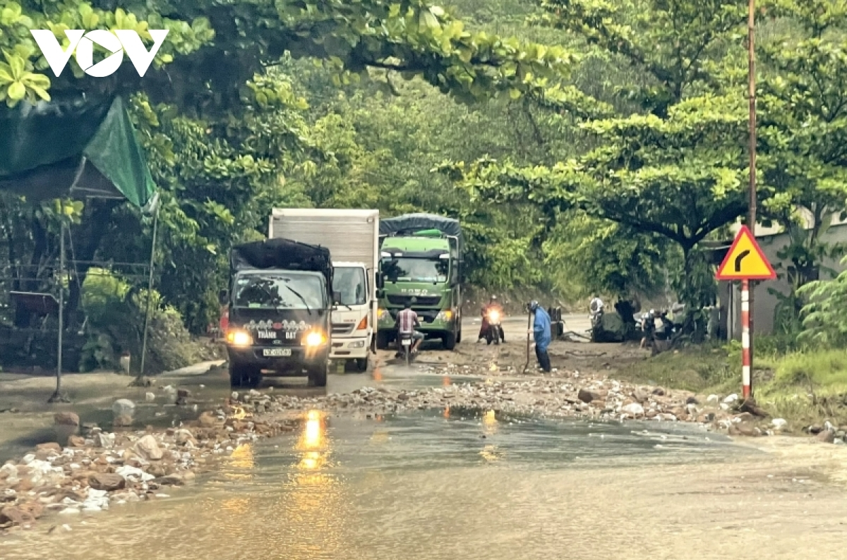 Soil and rock spill onto a section of National Highway 14B running through Quang Nam.