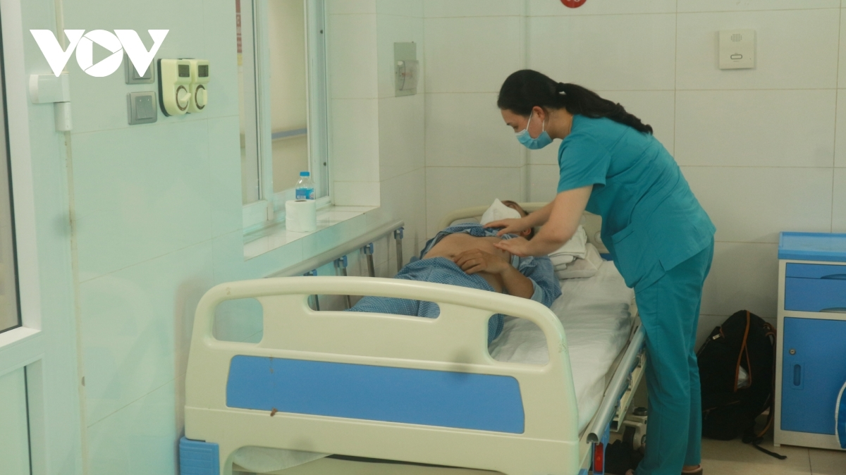 A dengue fever patient receives treatment at Thanh Nhan Hospital